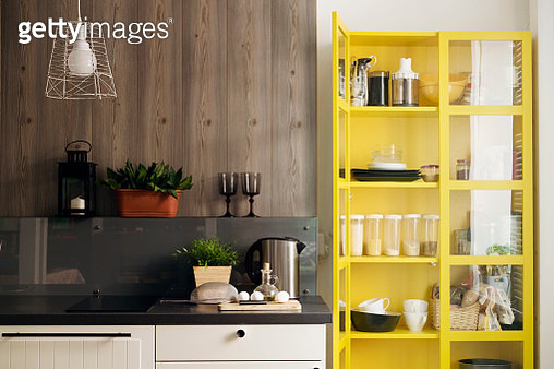 Yellow cabinet by kitchen counter at home - gettyimageskorea