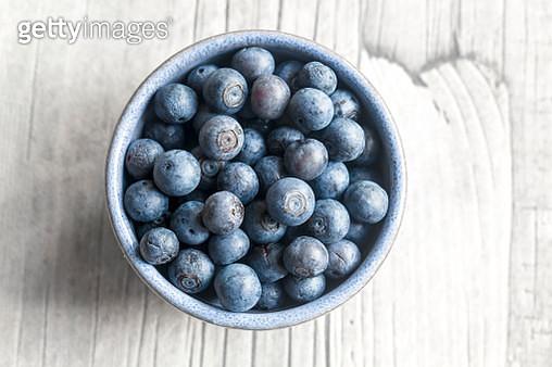 Bowl of blueberries on wood - gettyimageskorea