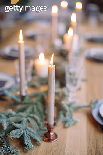 Close-Up Of Illuminated Candles On Table - gettyimageskorea