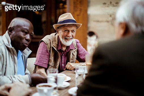 Close up of a group of seniors relaxing in a cafe after exploring the city - gettyimageskorea