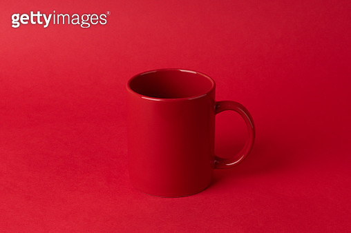 Red Mug on Red Colored Background Low Contrast Style. - gettyimageskorea