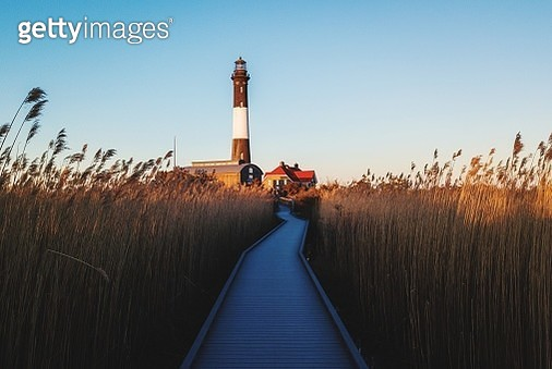 Boardwalk To Fire Island Lighthouse Against Sky - gettyimageskorea