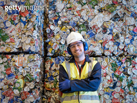 Recycle Worker With Bales Of Tin Cans - gettyimageskorea