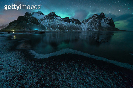 Stokksnes, Vestrahorn, Höfn, Iceland, Winter. This image was taken in Iceland during the end of the winter. It shows a beautiful landscapes and mountains with ice and snow and amazing light. It was taken during amazing northern lights. - gettyimageskorea