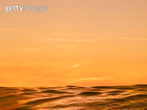 Golden sunset glow over ocean - gettyimageskorea
