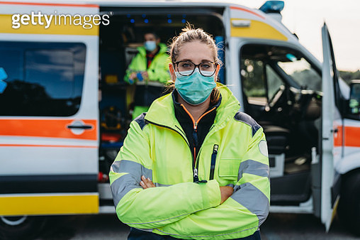 Portrait of a female paramedic in front of an ambulance outdoor - gettyimageskorea