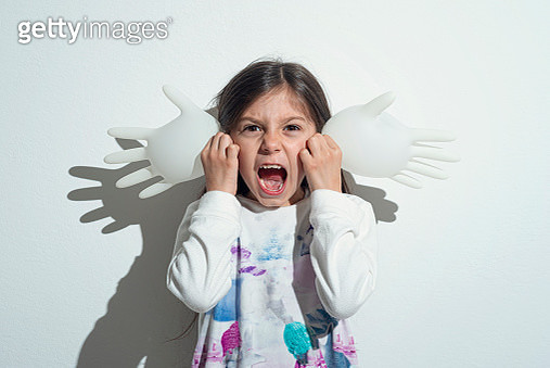 Girl playing with surgeon gloves inflated - gettyimageskorea
