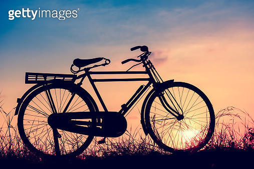 Silhouette Bicycle Against Sky During Sunset - gettyimageskorea