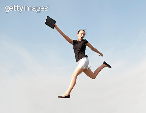 Low Angle View Of Woman Jumping Against Sky - gettyimageskorea