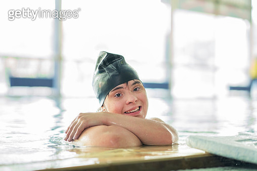 Teen girl with down syndrome at swimming pool - gettyimageskorea
