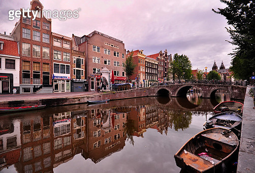 Bridge and old building reflected in Canal. Amsterdam, Netherlands - gettyimageskorea