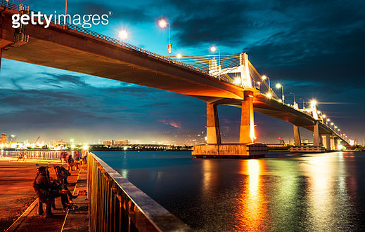 View Of Bridge Over River Against Cloudy Sky - gettyimageskorea