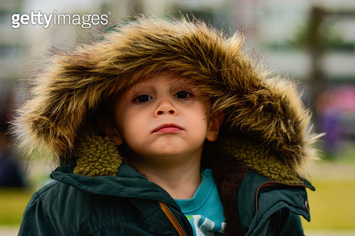 Close-Up Portrait Of Boy Wearing Warm Clothing - gettyimageskorea