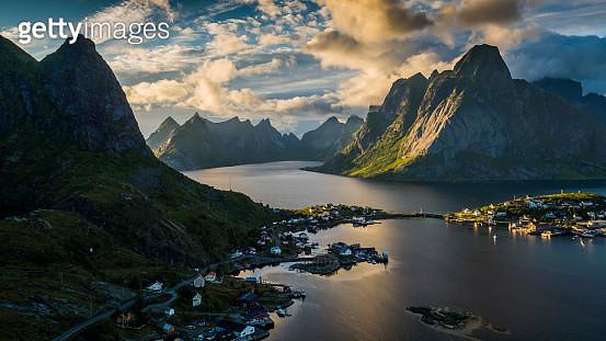 AERIAL: Reine Village and mountains of Moskenesoya, Lofoten Islands in Norway - gettyimageskorea