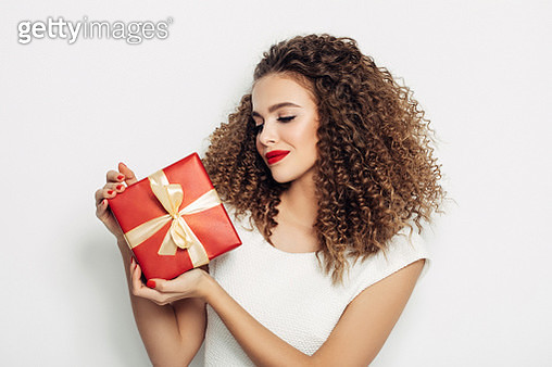 Beautiful woman with a Christmas gift - gettyimageskorea