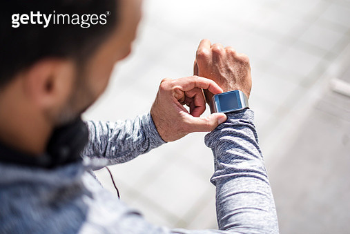 Close-up of athlete checking smartwatch - gettyimageskorea