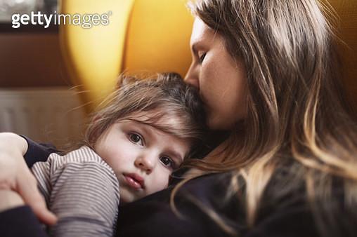 Mother hugs sad daughter - gettyimageskorea