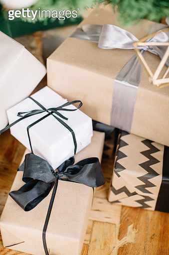 High Angle View Of Christmas Presents On Table - gettyimageskorea