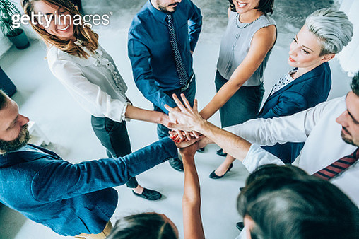 Business people joining hands in circle - gettyimageskorea