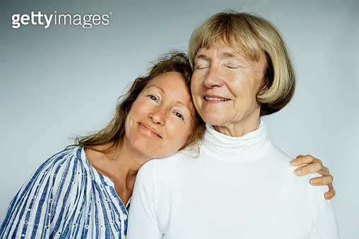 Portrait of mother and daughter on white background - gettyimageskorea