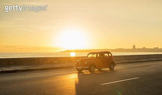 Old american car on El Malecon of Havana - gettyimageskorea