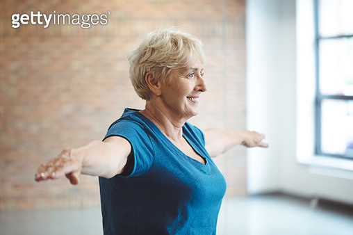 Senior woman having rehabilitation at health club - gettyimageskorea