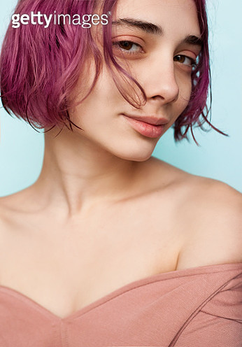 Young woman with colorful hair flying over her face - gettyimageskorea