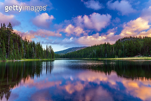 Mt. Bachelor during sunset, reflecting in the calm waters of Todd Lake. Bend, Oregon - gettyimageskorea