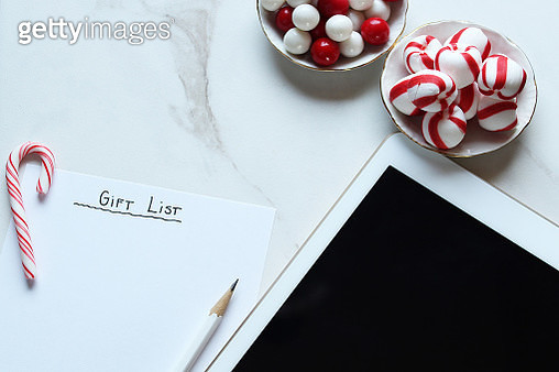 High Angle View Of Digital Tablet With Candies - gettyimageskorea