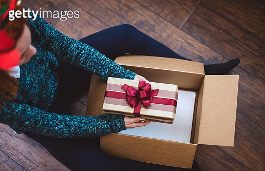 Young girl getting parcel during Christmas holidays - gettyimageskorea