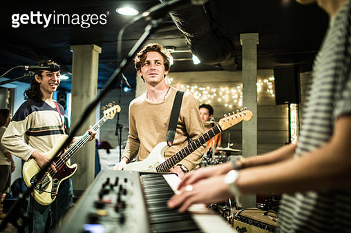 Young rock band rehearsing together and laughing - gettyimageskorea