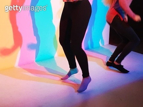Low Section Of Women Dancing In Illuminated Room - gettyimageskorea