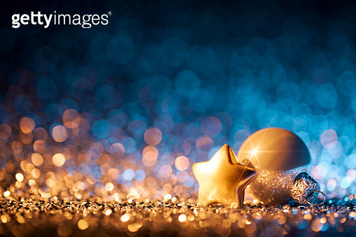 Christmas ornaments on defocused lights. Decorations Bokeh Blue Gold - gettyimageskorea