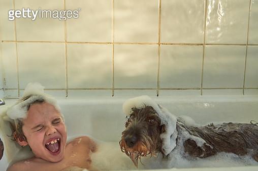 Having fun in a big bath full of bubbles - gettyimageskorea