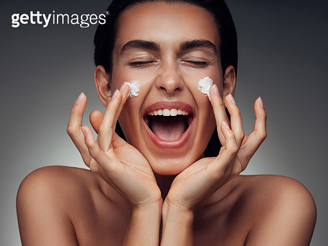 Girl inflicting cream - gettyimageskorea