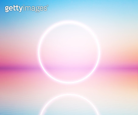 Perfect neon ring glowing at sunrise sky levitating over the sea. - gettyimageskorea