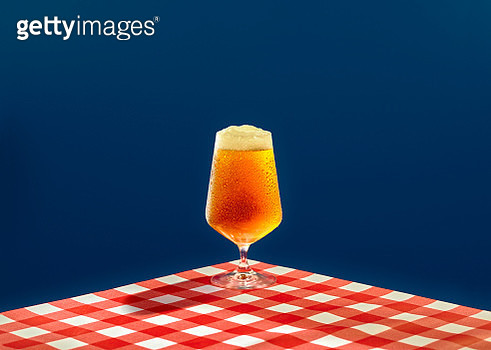Beer over a graphic background - gettyimageskorea