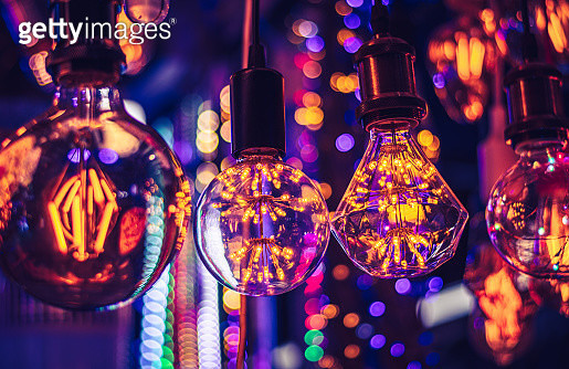 Close-Up of Illuminated Light Bulbs Hanging From Ceiling - gettyimageskorea