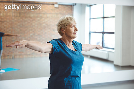 Senior woman exercising in rehabilitation centre - gettyimageskorea
