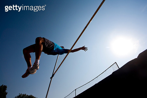 Athlete competes in high jump - gettyimageskorea