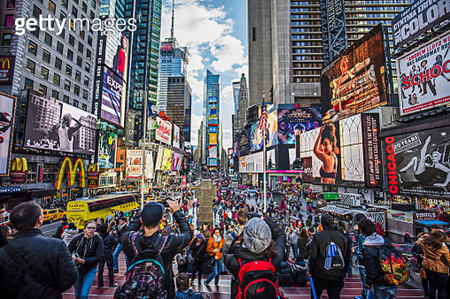 View of crowded Times Square in New York City. People are at major commercial intersection and neighborhood in Midtown Manhattan. Commercial signs are on buildings in city. Travel Locations. - gettyimageskorea