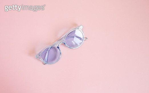 Summer picture with sunglasses over pink background. Flat lay. - gettyimageskorea
