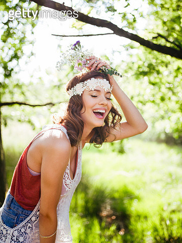 Teenager in boho style laughing happily in a summer park - gettyimageskorea