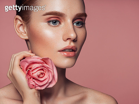 Beautiful woman with rose. Natural soft make-up. - gettyimageskorea
