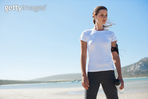 Woman runner relaxing and listening to mp3 player - gettyimageskorea