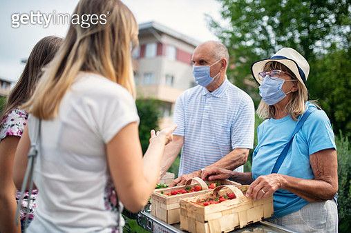 Senior couple selling groceries during COVID-19 pandemic - gettyimageskorea