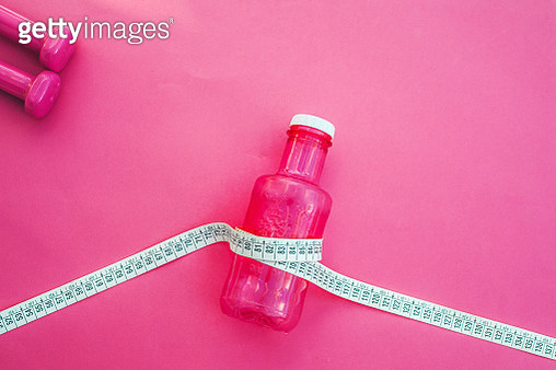 Measuring tape and Bottle of water. Exercise and Diet concept PINK - gettyimageskorea