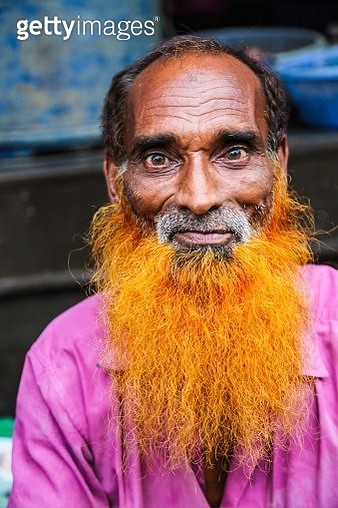Portrait Of Senior Man With Dyed Beard Sitting Outdoors - gettyimageskorea