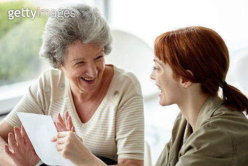 Mother and daughter holding prescription - gettyimageskorea
