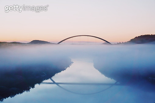 Bridge Over River Against Sky During Sunset - gettyimageskorea